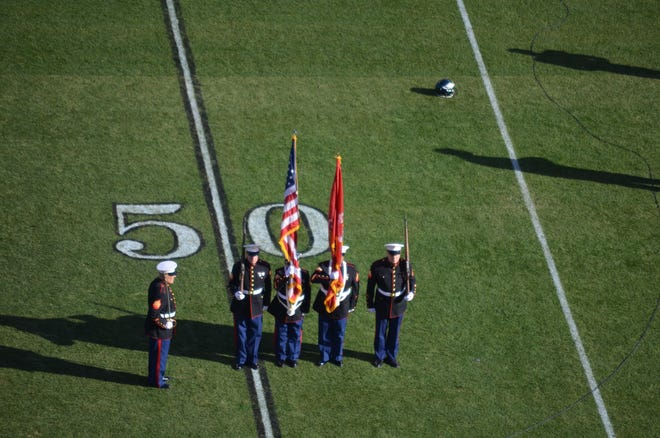 (From left) Dave McWilliams, Don Long, Bob Tesoroni Jr., Ron Colson and Bill Richmond, members of the Semper Marine Detachment 205, Vineland, served as the Honor Guard at the Philadelphia Eagles vs. Houston Texans football game on Dec. 23 at Lincoln Financial Field in Philadelphia.
