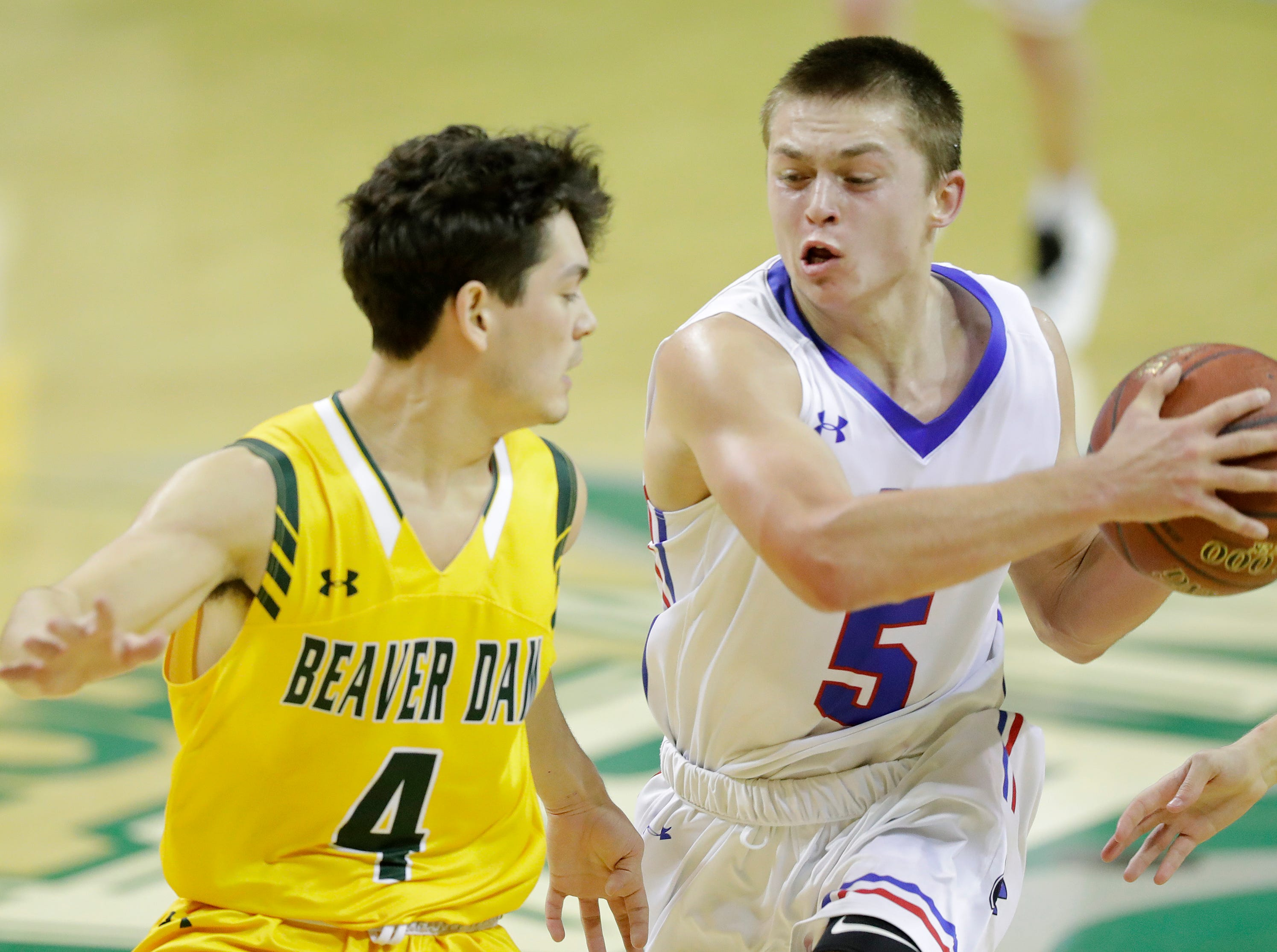 Merrill's Quinn Steckbauer (5) dribbles against Beaver Dam's Kendric Jimenez (4) at the Shawano Shootout at the Kress Center on Friday, December 28, 2018 in Green Bay, Wis.