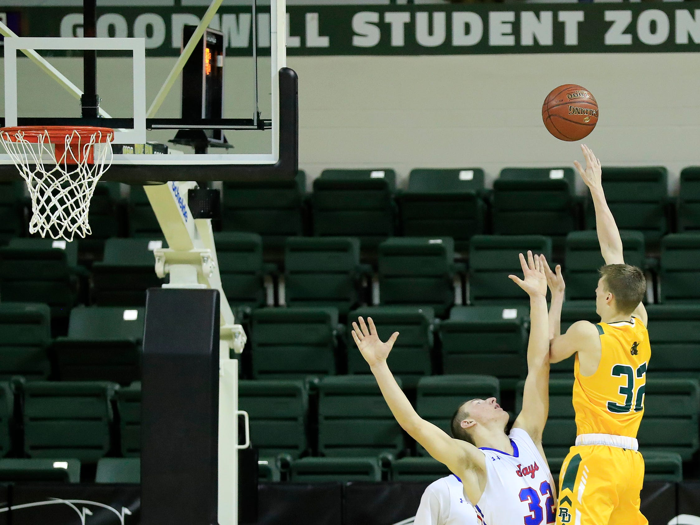 Beaver Dam's Jordan Schwanke (32) hits a shot at the buzzer to beat Merrill at the Shawano Shootout at the Kress Center on Friday, December 28, 2018 in Green Bay, Wis.