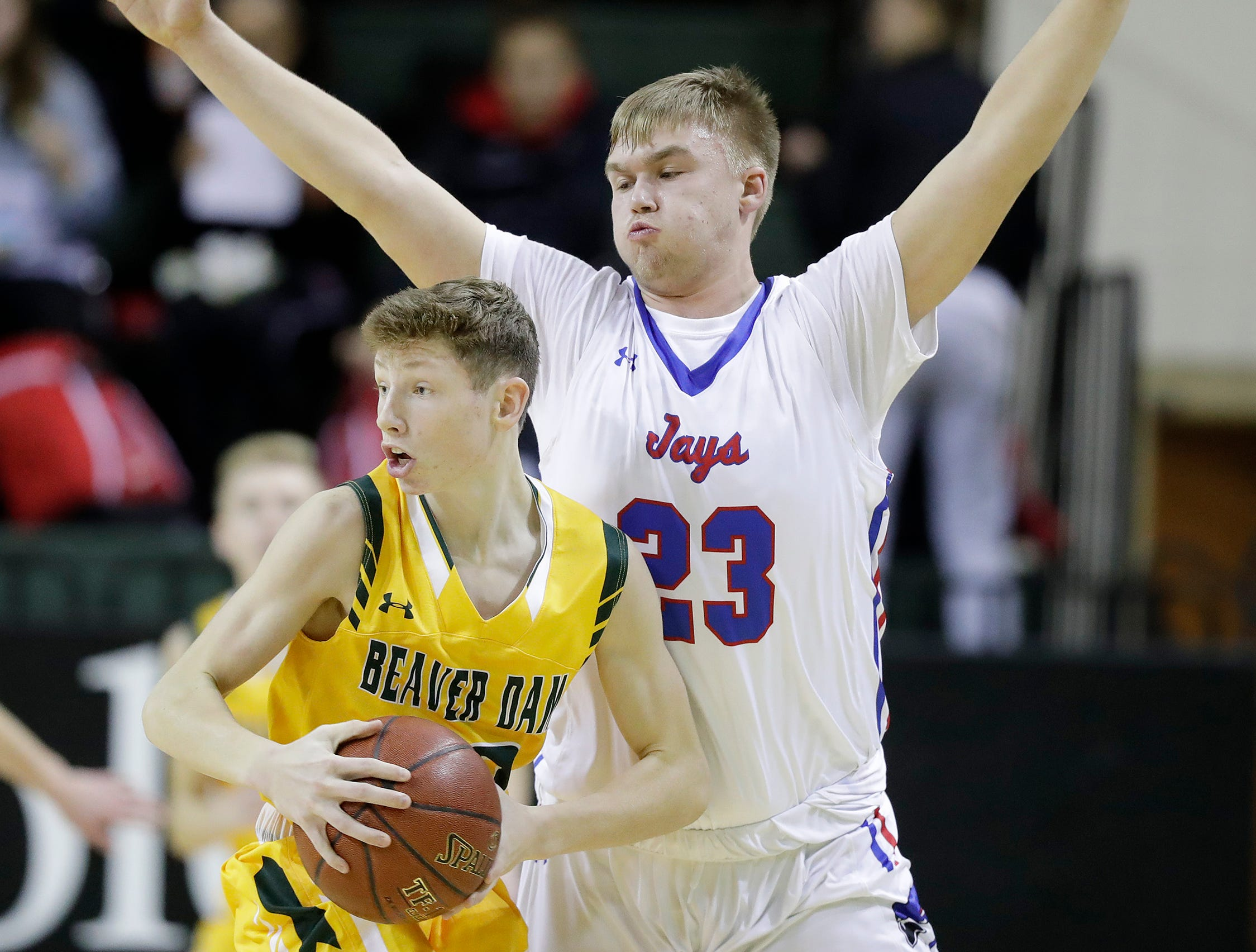 Merrill's Piersen Pyan (23) guards Beaver Dam's Nate Abel (30) at the Shawano Shootout at the Kress Center on Friday, December 28, 2018 in Green Bay, Wis.