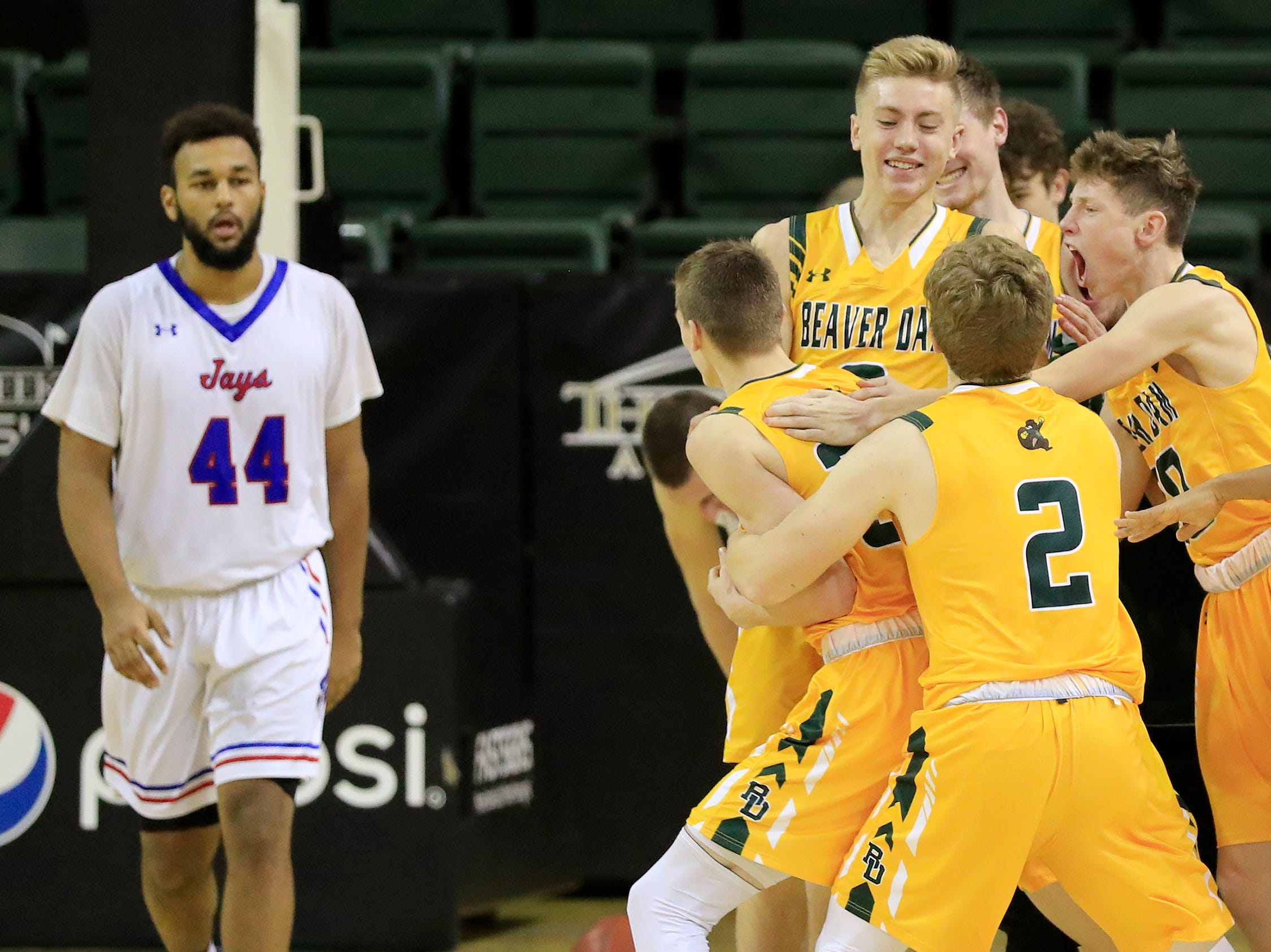 Beaver Dam players celebrate after defeating Merrill with a buzzer-beater at the Shawano Shootout at the Kress Center on Friday, December 28, 2018 in Green Bay, Wis.