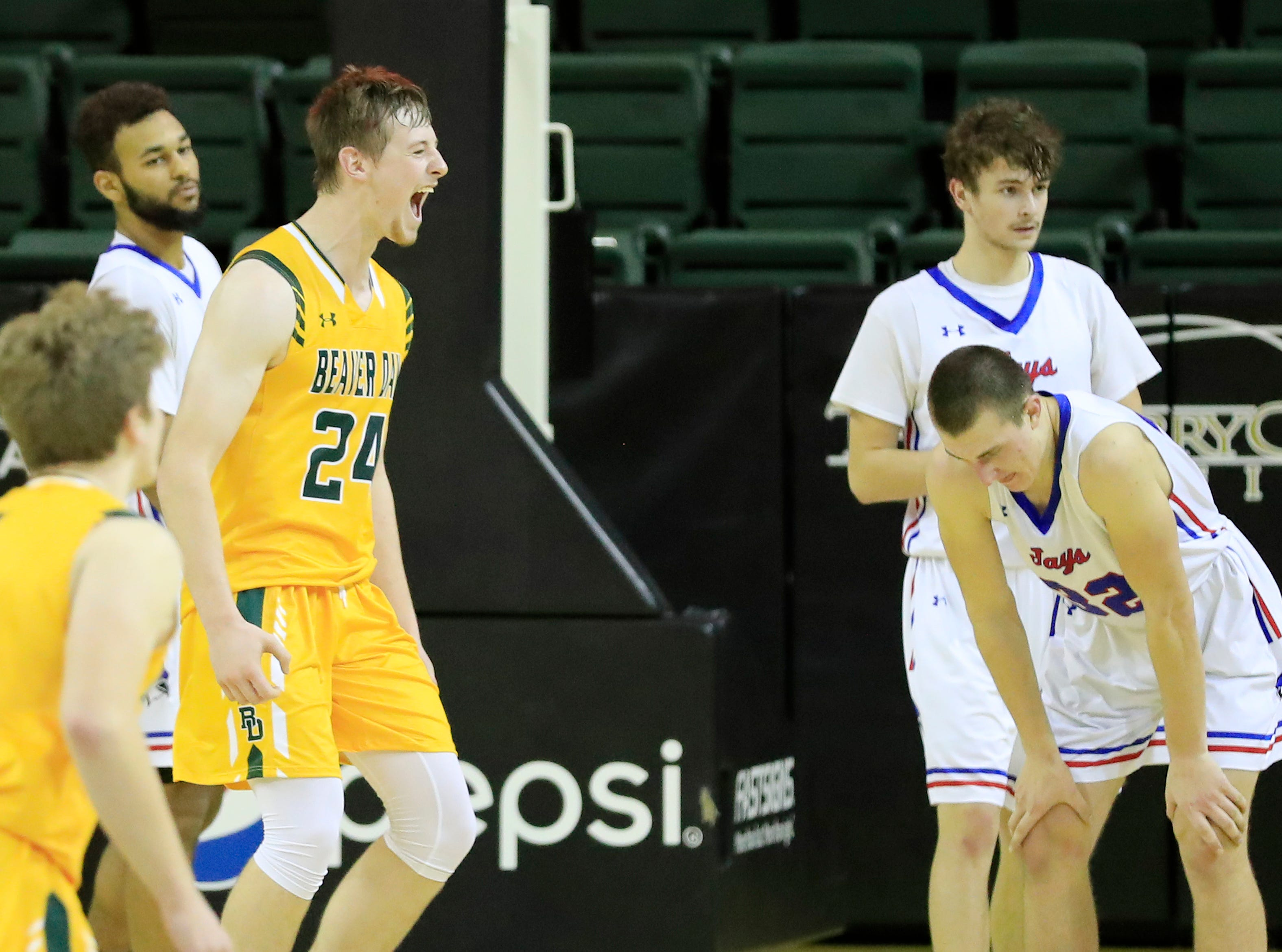 Beaver Dam's Marshall McGauley (24) celebrates after the Golden Beavers defeated Merrill with a buzzer-beater at the Shawano Shootout at the Kress Center on Friday, December 28, 2018 in Green Bay, Wis.