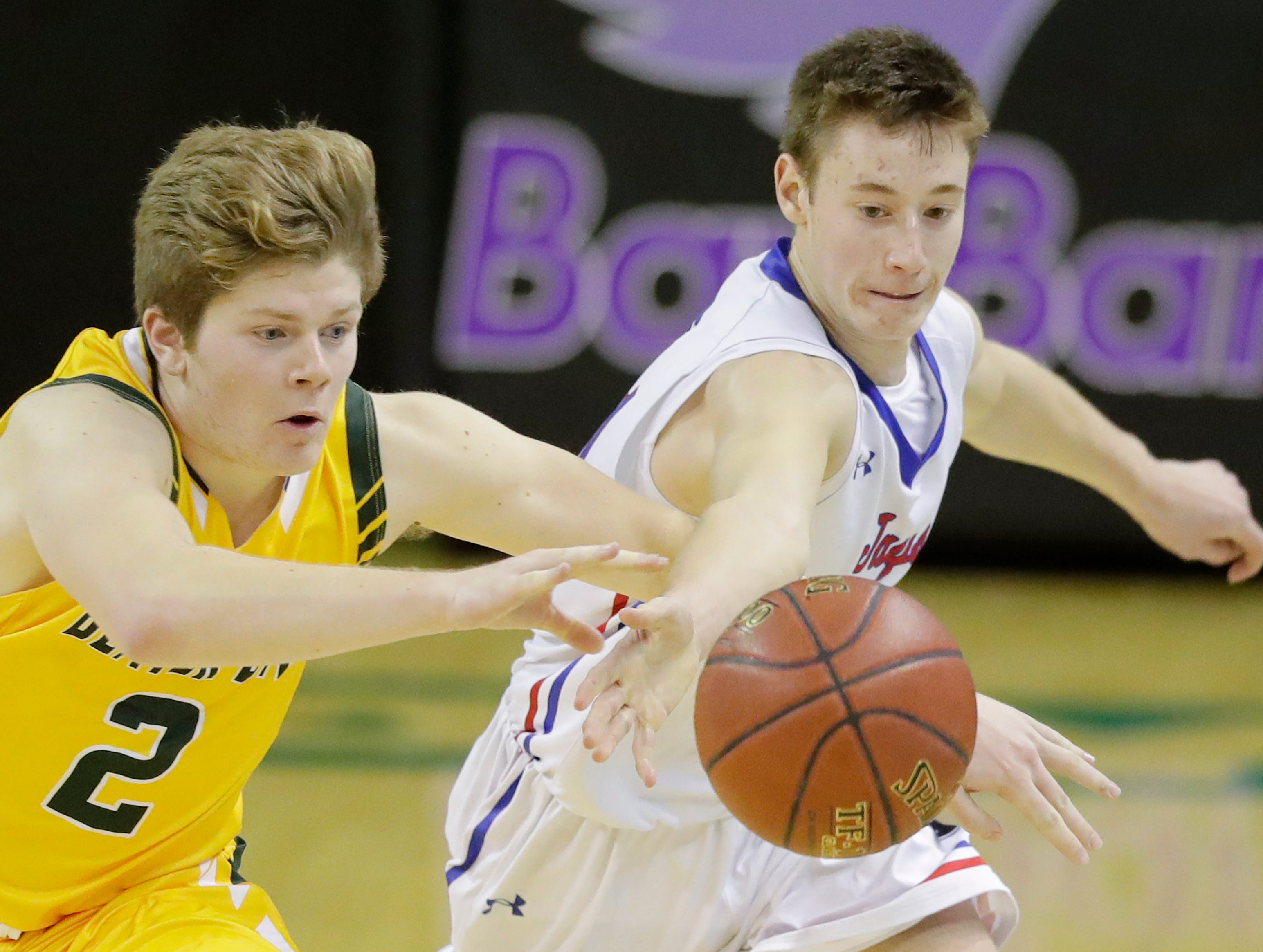 Merrill's Michael Casper (21) and Beaver Dam's Broden Boschert (2) chase down a loose ball at the Shawano Shootout at the Kress Center on Friday, December 28, 2018 in Green Bay, Wis.