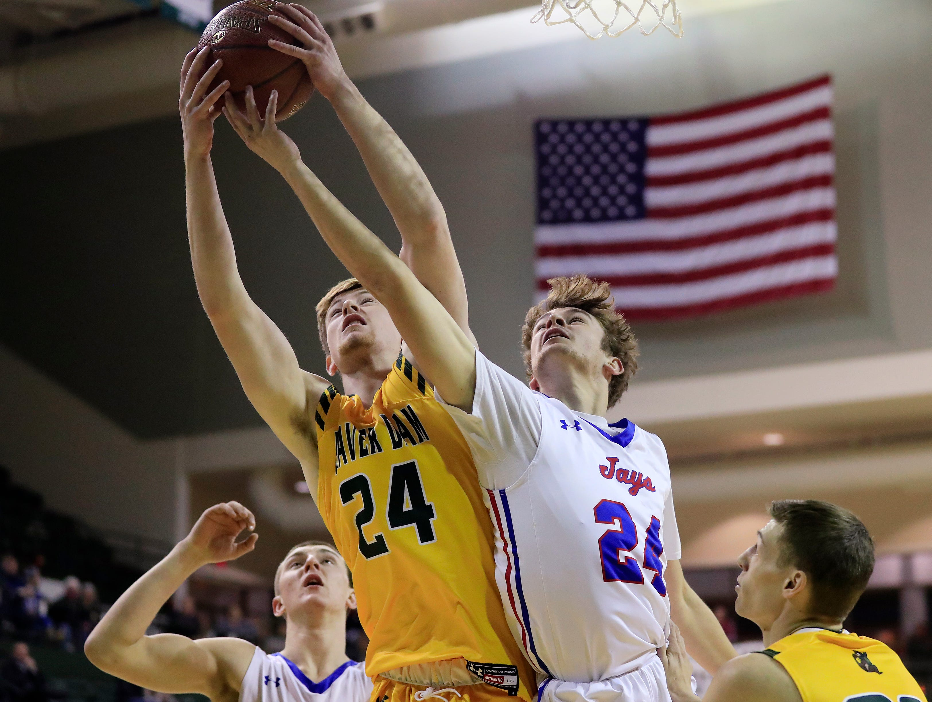 Merrill's Chase Bonnell (24) jumps for a rebound against Beaver Dam's Marshall McGauley (24) at the Shawano Shootout at the Kress Center on Friday, December 28, 2018 in Green Bay, Wis.