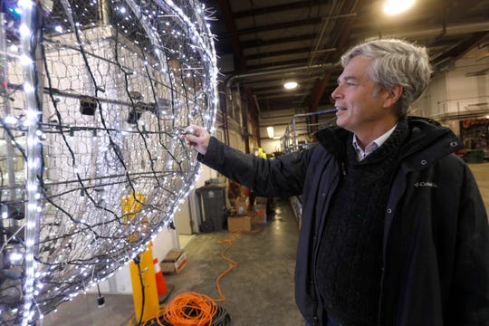 White Plains Mayor Thomas Roach inspects the 2018 New Year's Eve ball at the city Department of Public Works.