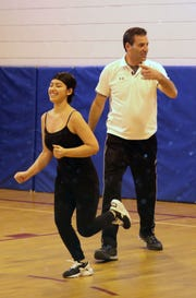 David Simon, the organizer of a basketball clinic, runs a drill with Maylyn Pittaluga, during a basketball clinic for the Family Services of Westchester at the North White Plains Community Center, Dec. 27, 2018.