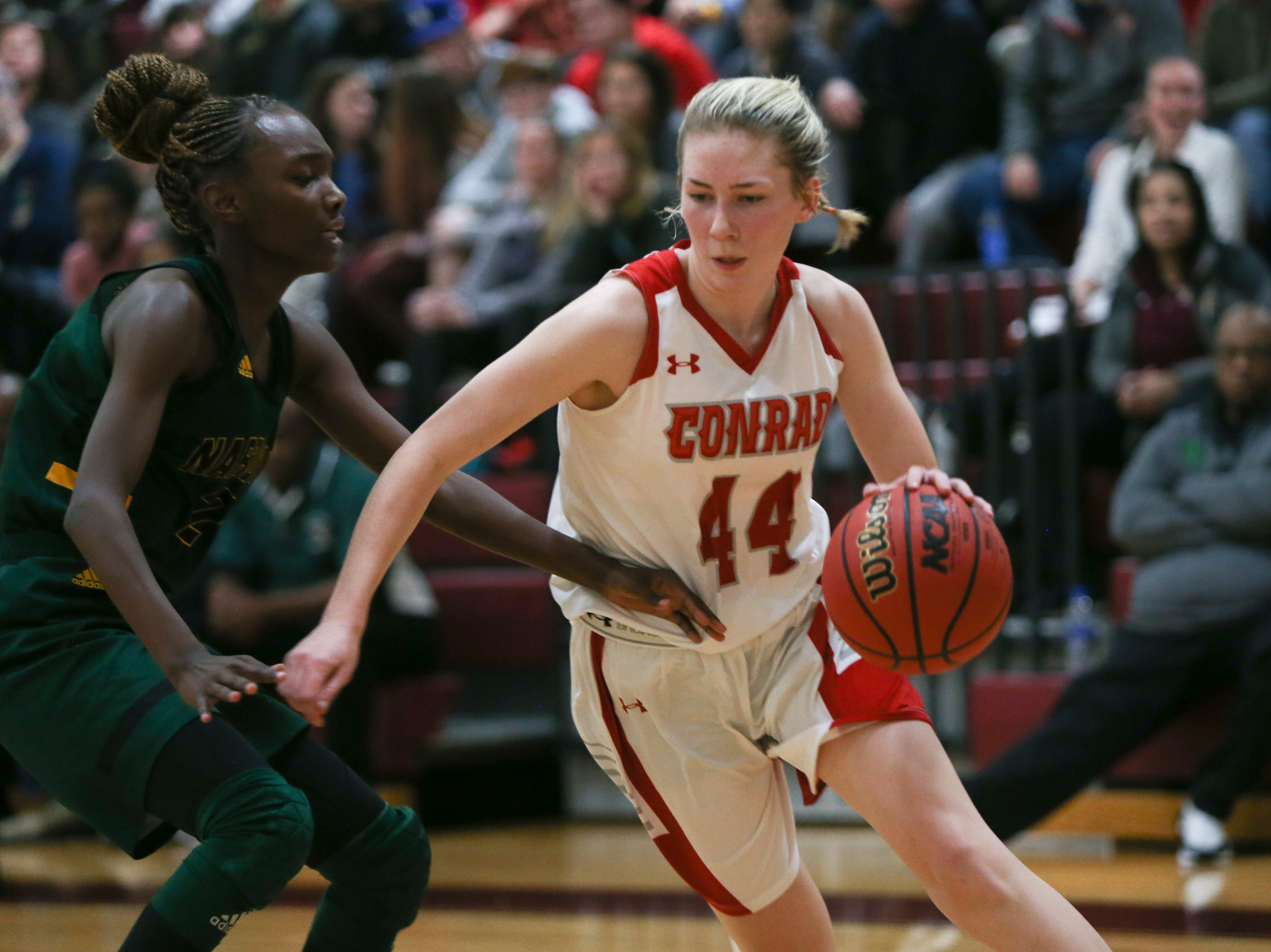 Conrad sophomore Stefanie Kulesza drives the baseline past Narbonne guard Keeya Smith. Conrad defeats Narbonne 54-35 in the Diamond State Classic at St. Elizabeth High School Thursday.