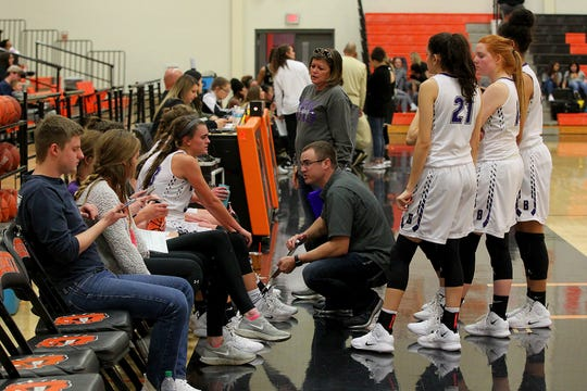 Benjamin's coach's Cody Propps and Mindy Myers talks to the Lady Stangs during a timeout Friday as the Rider Raiders took on the Benjamin Lady Stangs  in the Union Square Lady Bulldog Christmas Classic in Burkburnett.