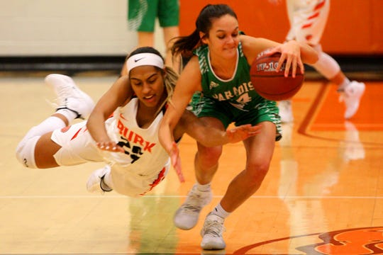 Burkburnett's Eternity Jackson goes for the ball Friday as the Lady Bulldogs took on the Paradise Lady Panthers in the Union Square Lady Bulldog Christmas Classic in Burkburnett.