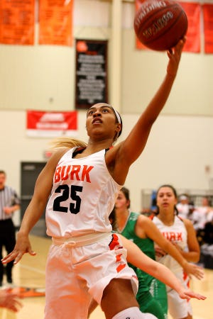 Burkburnett's Eternity Jackson goes in for a layup Friday against Paradise at the Union Square Lady Bulldog Christmas Classic.