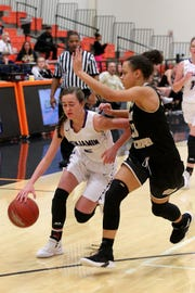 Temi Flowers of Benjamin dribbles under Riders Jaelynn White Friday as the Rider Raiders took on the Benjamin Lady Stangs  in the Union Square Lady Bulldog Christmas Classic in Burkburnett.