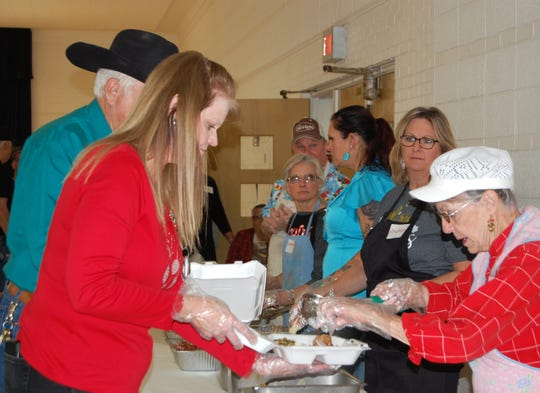 Volunteers at the 32nd annual Christmas Holiday Spirit Meal in Vernon performed a number of tasks including stirring potatoes as they prepared for the huge free meal served at Wilbarger Memorial Auditorium Christmas Day.