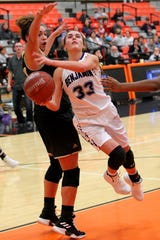 Macy Flowers of Benjamin goes under for the layup on Riders Addy Self Friday as the Rider Raiders took on the Benjamin Lady Stangs  in the Union Square Lady Bulldog Christmas Classic in Burkburnett.