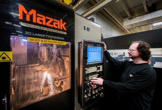 In this Dec. 5, 2018 photo, machinist Scott Ringenberg of Case IH-Goodfield runs a $1.8 million tube laser unit that does multiple cuts on tubing in at the plant in Goodfield, Ill. Case IH-Goodfield has expanded with a $17 million investment to update their factory location in Goodfield. The plant manufactures tillage and fertilizer application equipment for customers across the world.