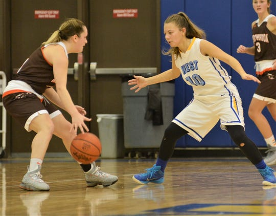 West Muskingum's Maddi Curtis defends Meadowbrook's Avery Poland.