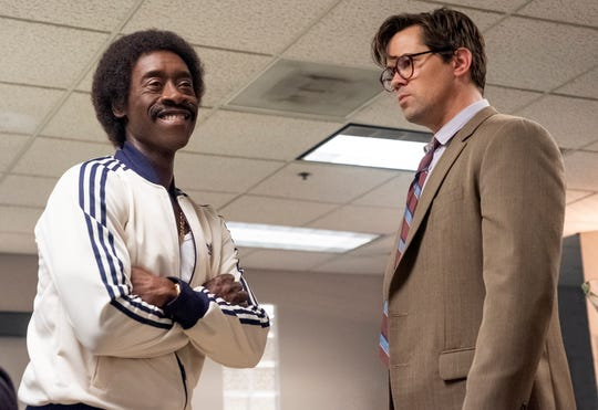 "Don Cheadle as Maurice Monroe and Andrew Ranells as Blair Pfaff in ""Black Monday."""