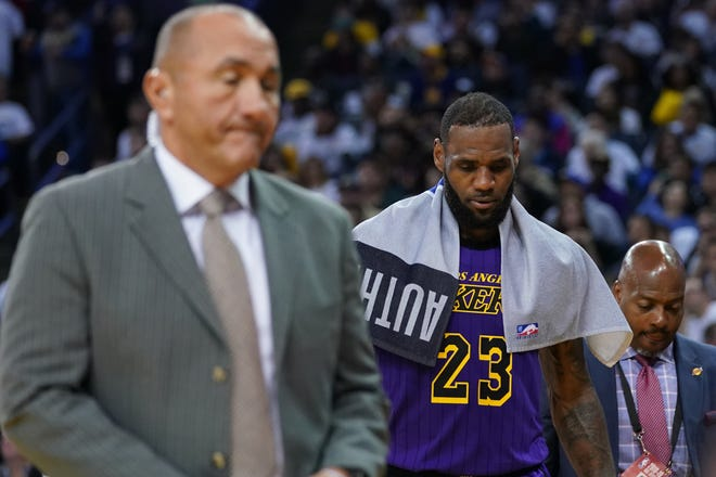 Los Angeles Lakers forward LeBron James leaves the court after an injury during the third quarter against the Golden State Warriors at Oracle Arena on Christmas Day.