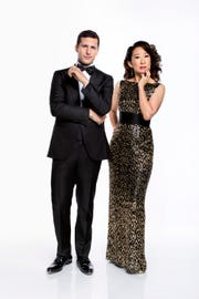 Andy Samberg, left, and Sandra Oh, who presented together at the Emmys, will co-host NBC's 'Golden Globe Awards.'