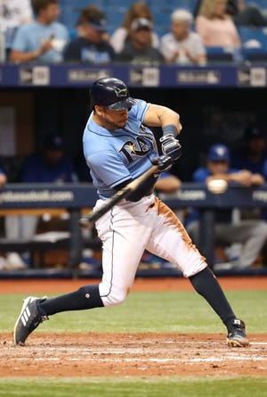 Tampa Bay Rays left fielder Tommy Pham (29) singles during the seventh inning against the Toronto Blue Jays at Tropicana Field.