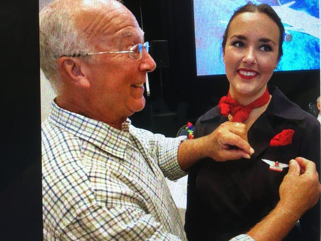 Hal Vaughan pins wings on daughter Pierce Vaughan after she completed flight attendant training at Delta Air Lines in Atlanta earlier this year.