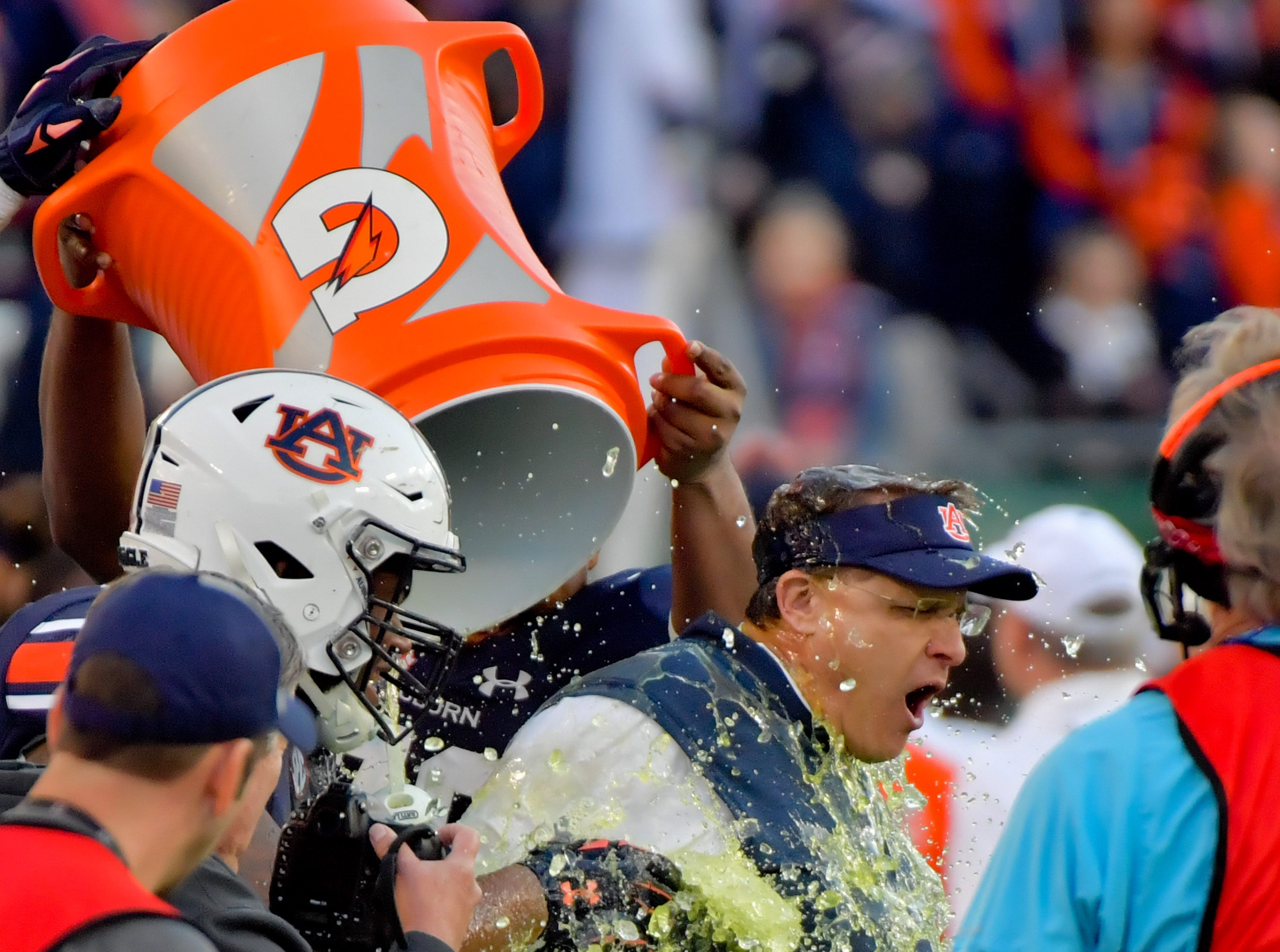 Auburn Tigers head coach Gus Malzahn is doused with Gatorade by his team during the second half of the Music City Bowl.
