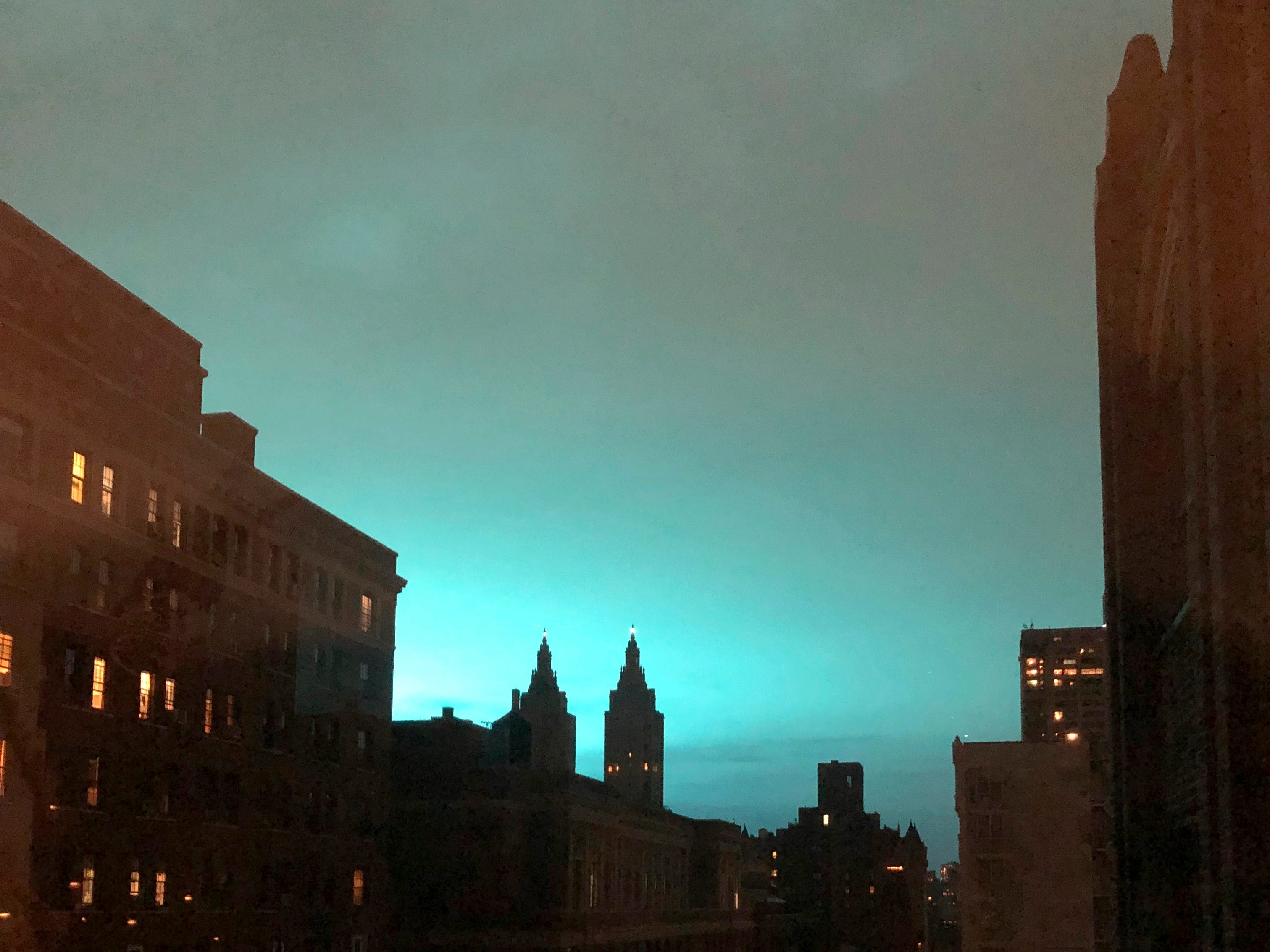 This photo shows blue light over New York, as seen from Manhattan Brough of New York on Thursday, Dec. 27, 2018. New York police said a transformer exploded at a Con Edison facility in Queens on Thursday, causing some power outages. (AP Photo/Jay Reeves) ORG XMIT: RPJR401