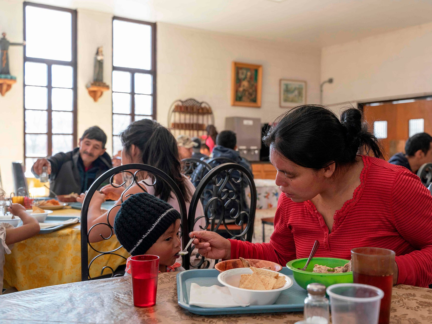 Magdelena, a Guatemalan migrant, feeds her toddler son at Holy Cross Retreat Center, which has become a makeshift shelter for migrants released by Immigration and Customs Enforcement (ICE), in Las Cruces, New Mexico, on Dec. 27, 2018. She was part of a group of 1,300 people unexpectedly released by ICE over the Christmas holidays. Shelters in El Paso, inundated with migrants, have coordinated with Las Cruces Shelters to house migrants the day they are released from ICE custody.
