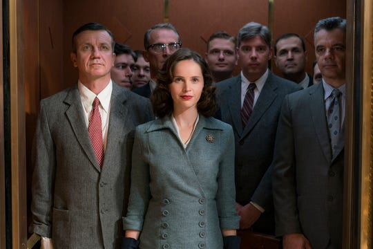 British actress Felicity Jones, center, plays an ambitious younger version of RBG.