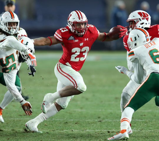 Wisconsin running back Jonathan Taylor carries the ball against Miami (Fla.) in the 2018 Pinstripe Bowl.