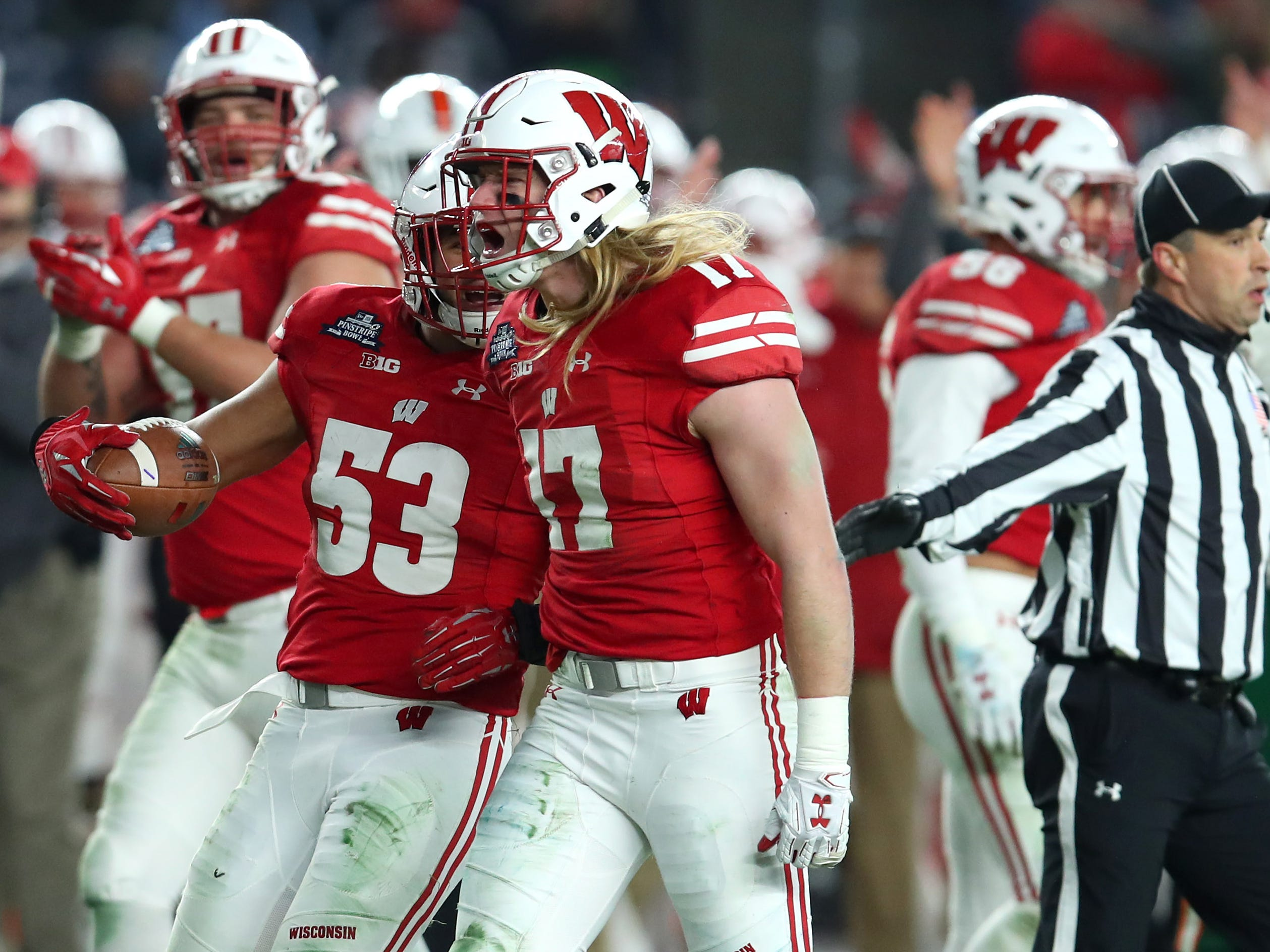 Wisconsin linebacker Andrew Van Ginkel (17) reacts to a defensive play with teammate T.J. Edwards (53) against  Miami during the second quarter in the Pinstripe Bowl at Yankee Stadium.