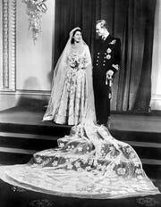 Britain's Princess Elizabeth (future Queen Elizabeth II)  and Philip, Duke of Edinburgh, pose on their wedding day at Buckingham Palace in London on Nov. 20, 1947.