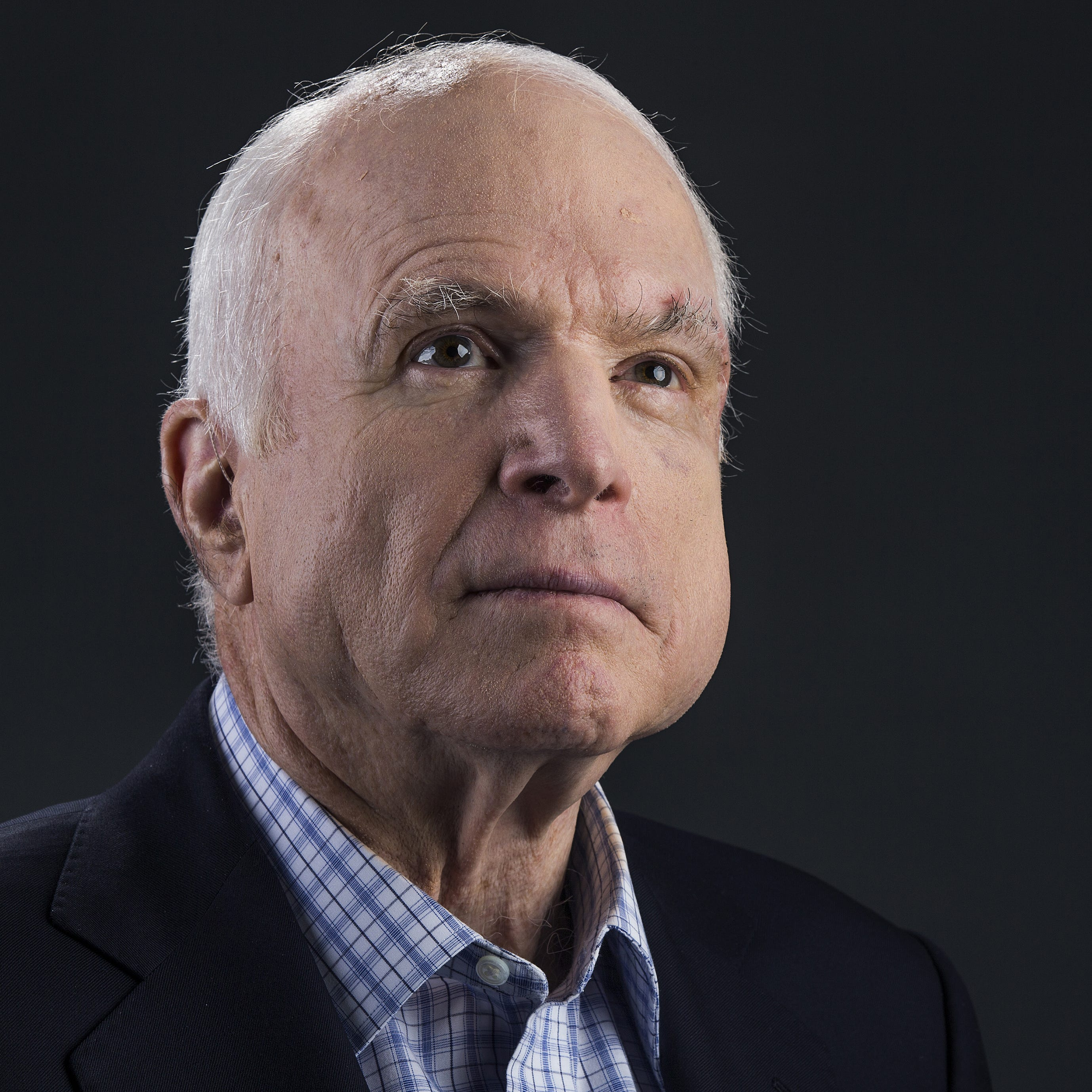 Sen. John McCain poses at the Republic Media building in downtown Phoenix, Thursday August 3, 2017.