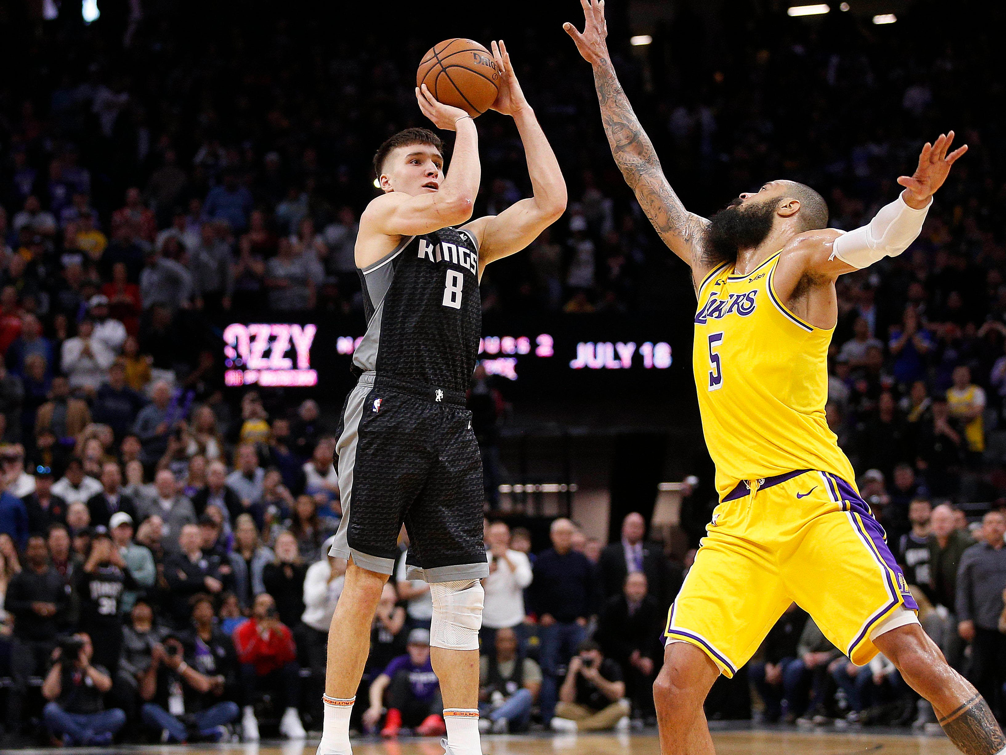 Dec. 27: Kings guard Bogdan Bogdanovic (8) puts up the game-winning 3 over Lakers center Tyson Chandler (5) at the buzzer in Sacramento.