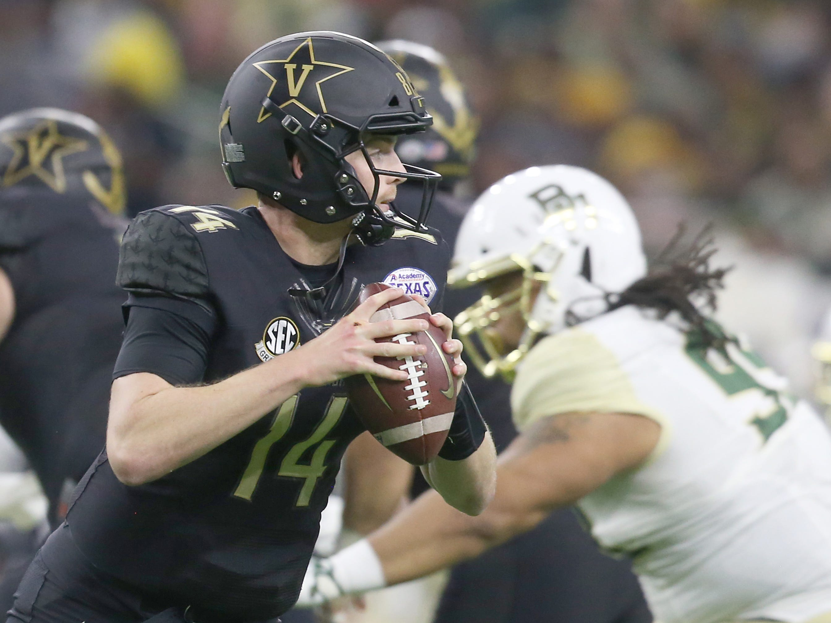 Vanderbilt  quarterback Kyle Shurmur looks to pass  against Baylor in the Texas Bowl.