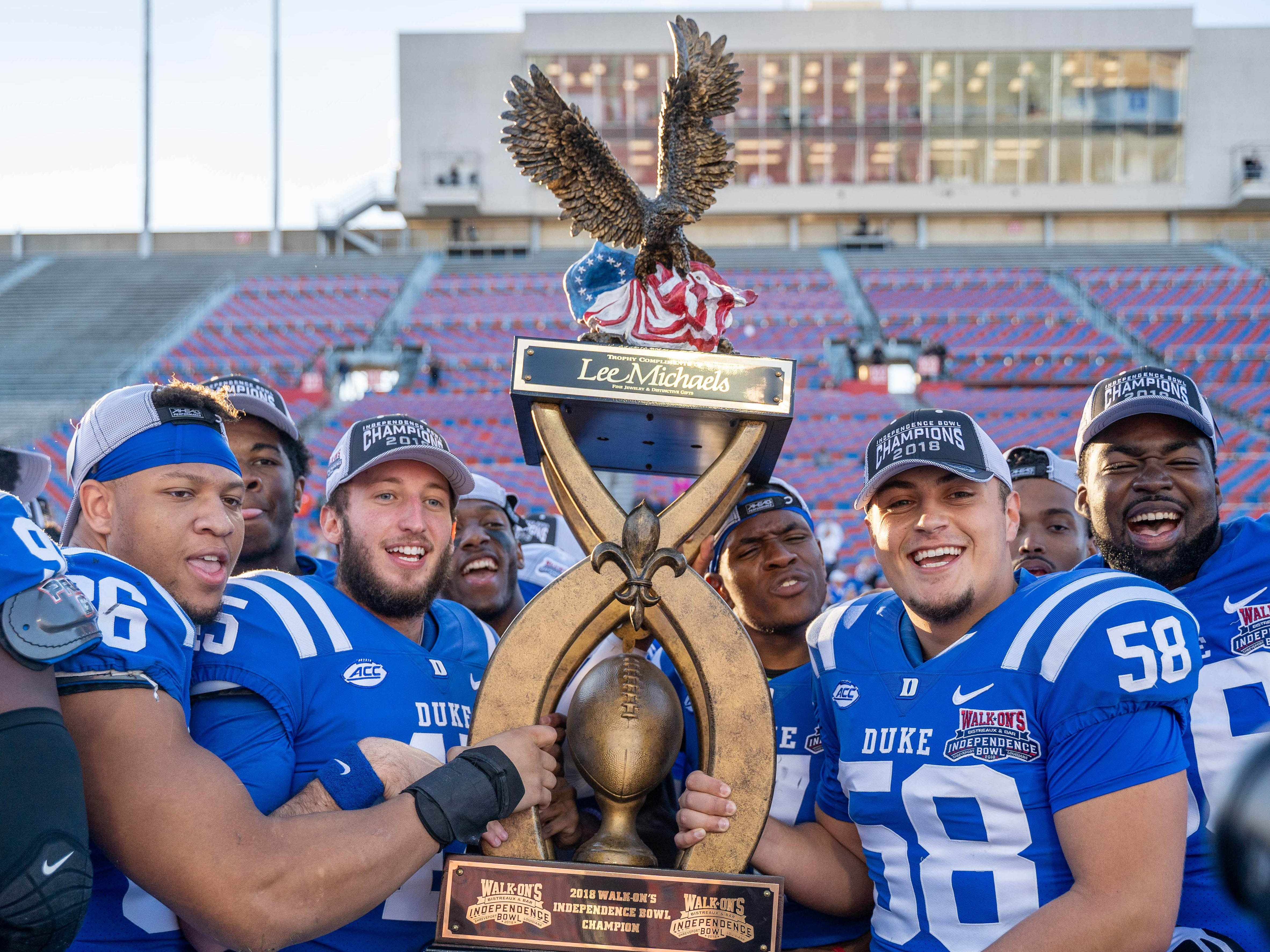 Duke players celebrate their victory in the Independence Bowl.