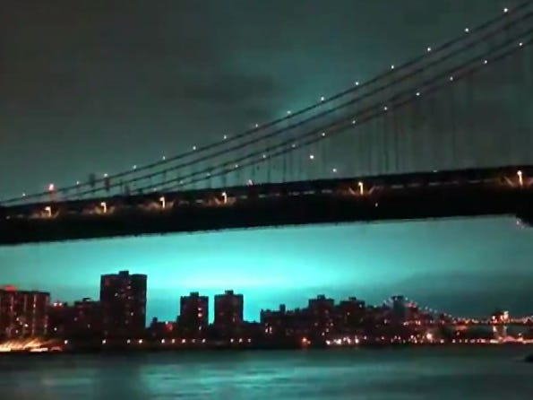 "This video grab taken from footage obtained courtesy of Alexander C. Kane taken on December 27, 2018, shows a blue light caused by a transformer explosion at a power plant in Queens on December 27, 2018. - An alien invasion? The Rapture? The sky flashed an eerie blue over New York City on Thursday night, December 27, 2018, and social media users feared the worst. In the end, the explanation turned out to be somewhat more mundane: a problem at a local power plant. ""The lights you have seen throughout the city appear to have been from a transformer explosion at a Con Ed facility in Queens. The fire is under control, will update as more info becomes available,"" the New York Police Department tweeted. (Photo by Alexander C. KANE / Twitter accout of Alexander C. Kane / AFP) / RESTRICTED TO EDITORIAL USE - MANDATORY CREDIT ""AFP PHOTO / ALEXANDER C. KANE / TWITTER"" - NO MARKETING NO ADVERTISING CAMPAIGNS - DISTRIBUTED AS A SERVICE TO CLIENTS ---ALEXANDER C. KANE/AFP/Getty Images ORIG FILE ID: AFP_1BV05I"