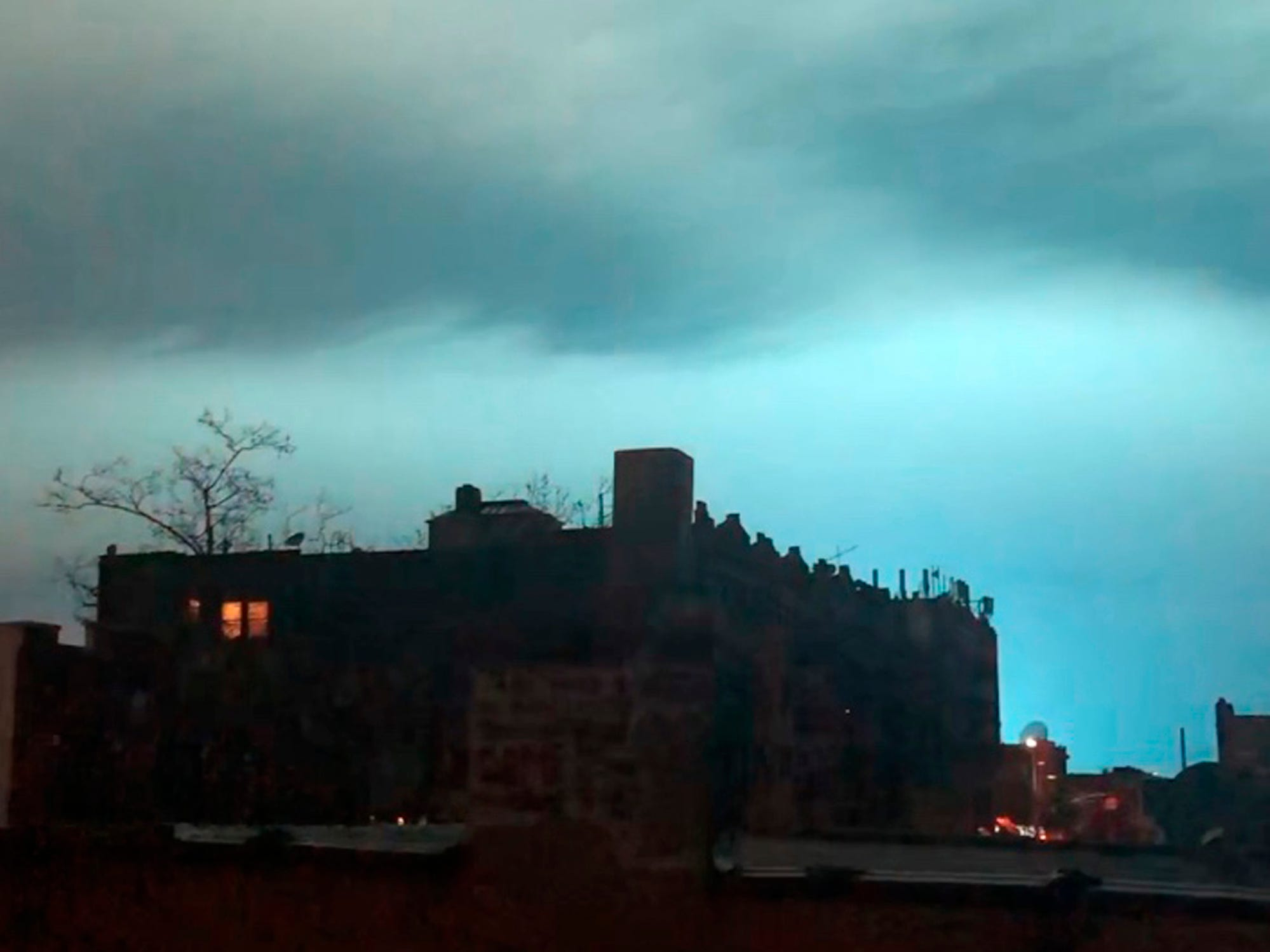 In this image taken from video, the night sky is illuminated in a bright, blue color after an explosion in the Queens borough of New York, Thursday, Dec. 27, 2018. New York police say a transformer exploded at a Con Edison facility in Queens. The explosion caused a bright, blue light that illuminated the New York skyline and caused a stir on social media. (AP Photo/Sophie Rosenbaum) ORG XMIT: NYR107