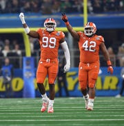 Clemson defensive linemen Clelin Ferrell (99) and Christian Wilkins at the Cotton Bowl on December 29, 2018.
