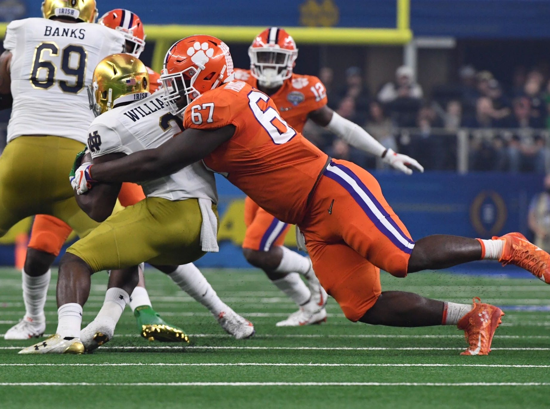 Clemson's Albert Huggins (67) makes a tackle on Notre Dame's Dexter Williams in the first quarter of the Cotton Bowl on December 29, 2018.