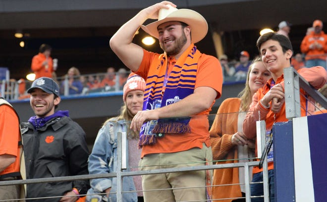 Fans watch Clemson warm up before kickoff at the College Football Playoff Semifinal at the Goodyear Cotton Bowl Classic at AT&T Stadium in Arlington, Texas Saturday, December 29, 2018.