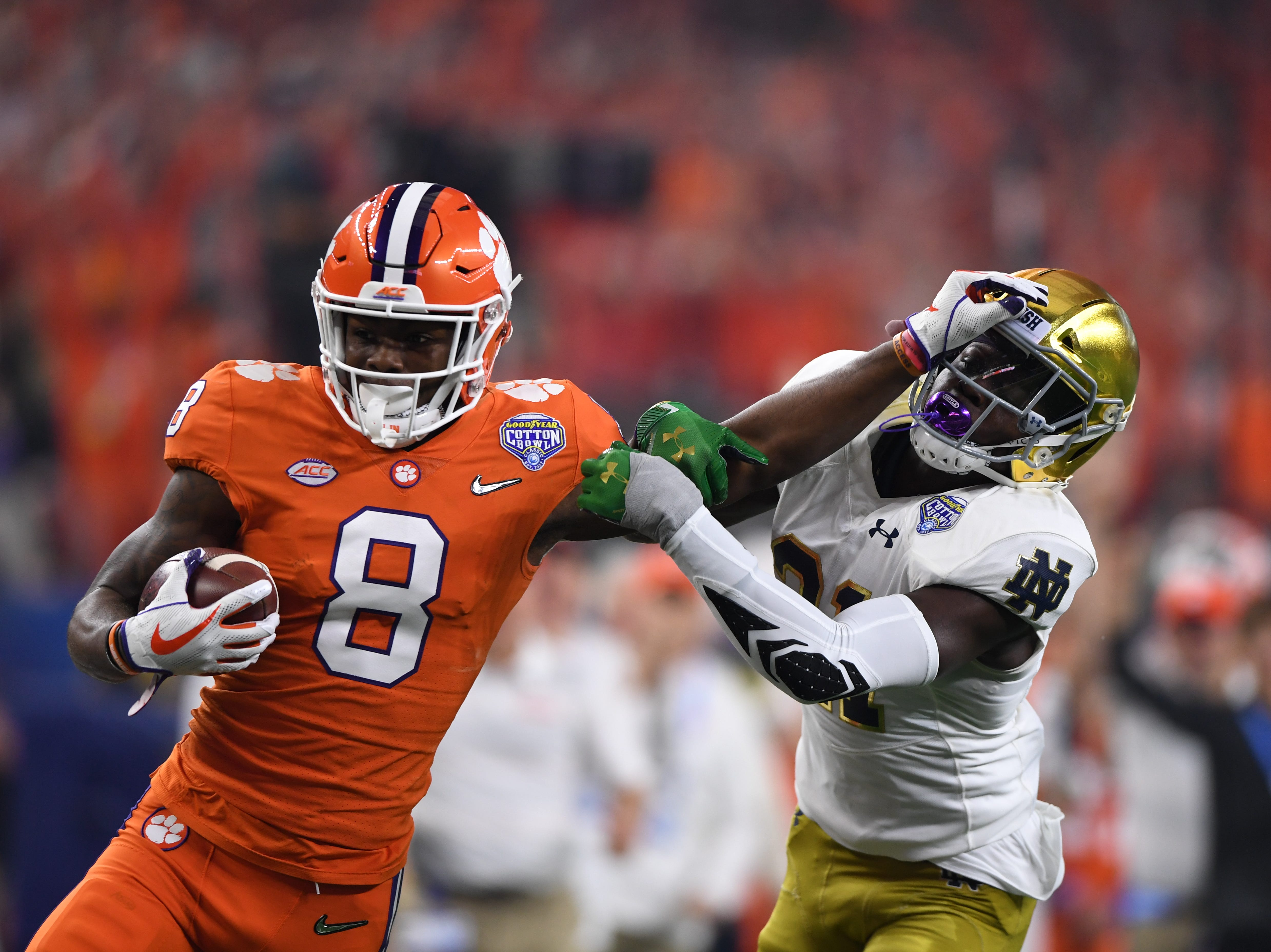 Clemson's Justyn Ross stiff arms a Notre Dame defender on his way to a 52-yard touchdown in the second quarter of the Cotton Bowl on December 29, 2018.