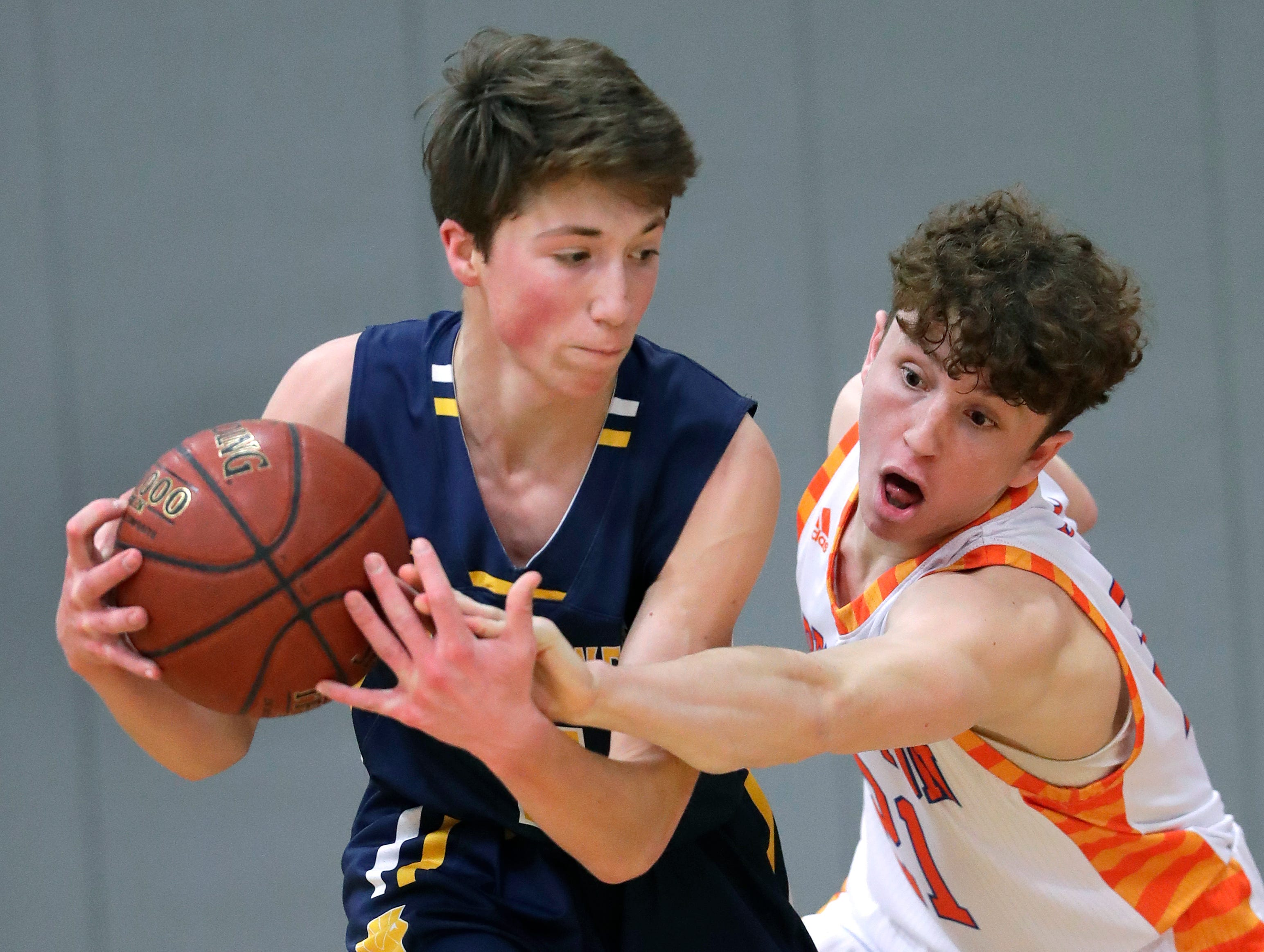 Appleton West  High School's Will Mahoney (21) tries to steal the ball against Wausau West High School's Tim Deloye (11) during their boys basketball game Friday, December 28, 2018, in Appleton, Wis. Dan Powers/USA TODAY NETWORK-Wisconsin