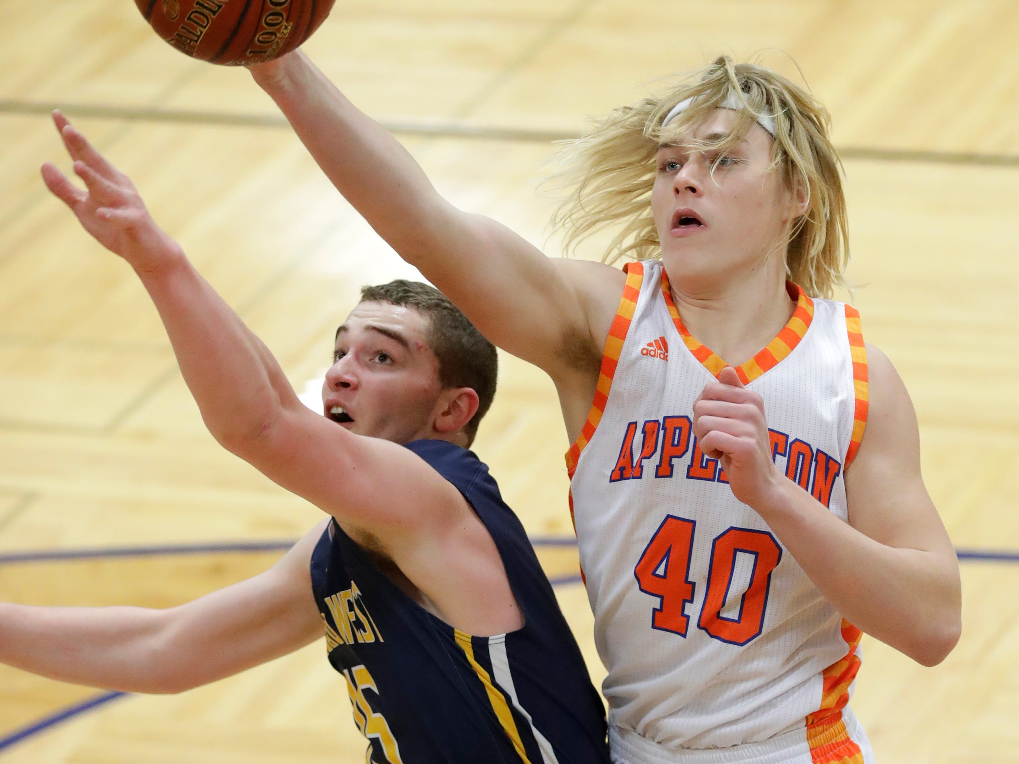 Appleton West  High School's Carson Hacker (40) defends against Wausau West High School's Jacob Rapp (15) during their boys basketball game Friday, December 28, 2018, in Appleton, Wis. Dan Powers/USA TODAY NETWORK-Wisconsin