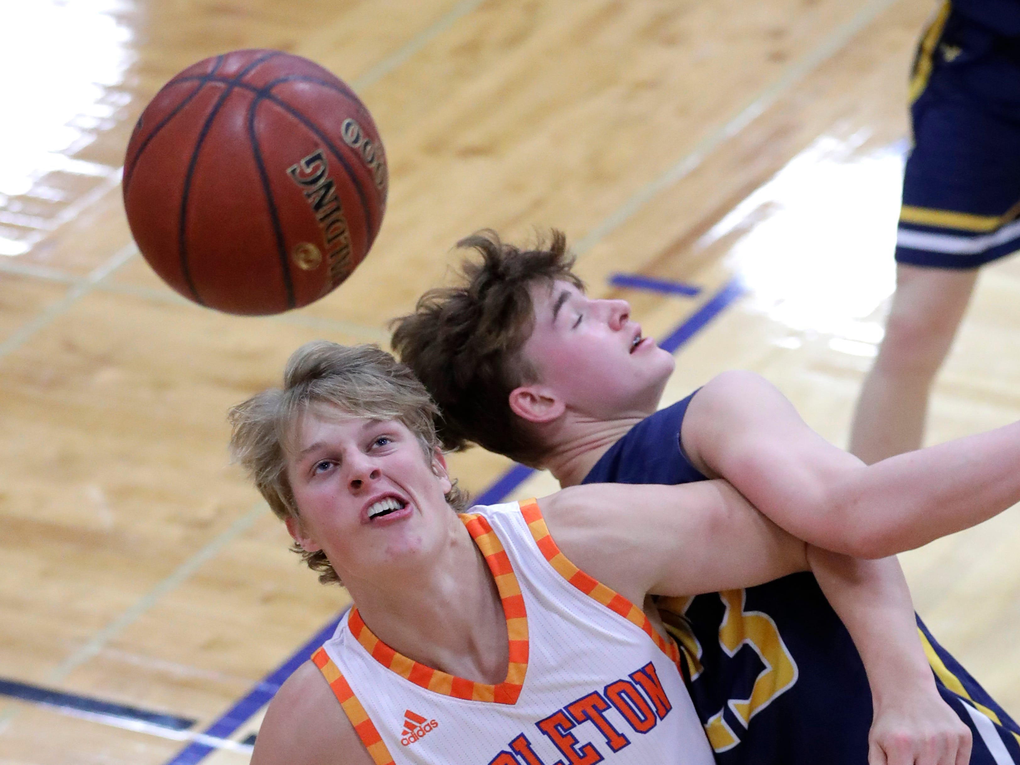 Appleton West  High School's Sam Pitz (31) positions himself for a rebound against Wausau West High School's Logan White (23) during their boys basketball game Friday, December 28, 2018, in Appleton, Wis. Dan Powers/USA TODAY NETWORK-Wisconsin