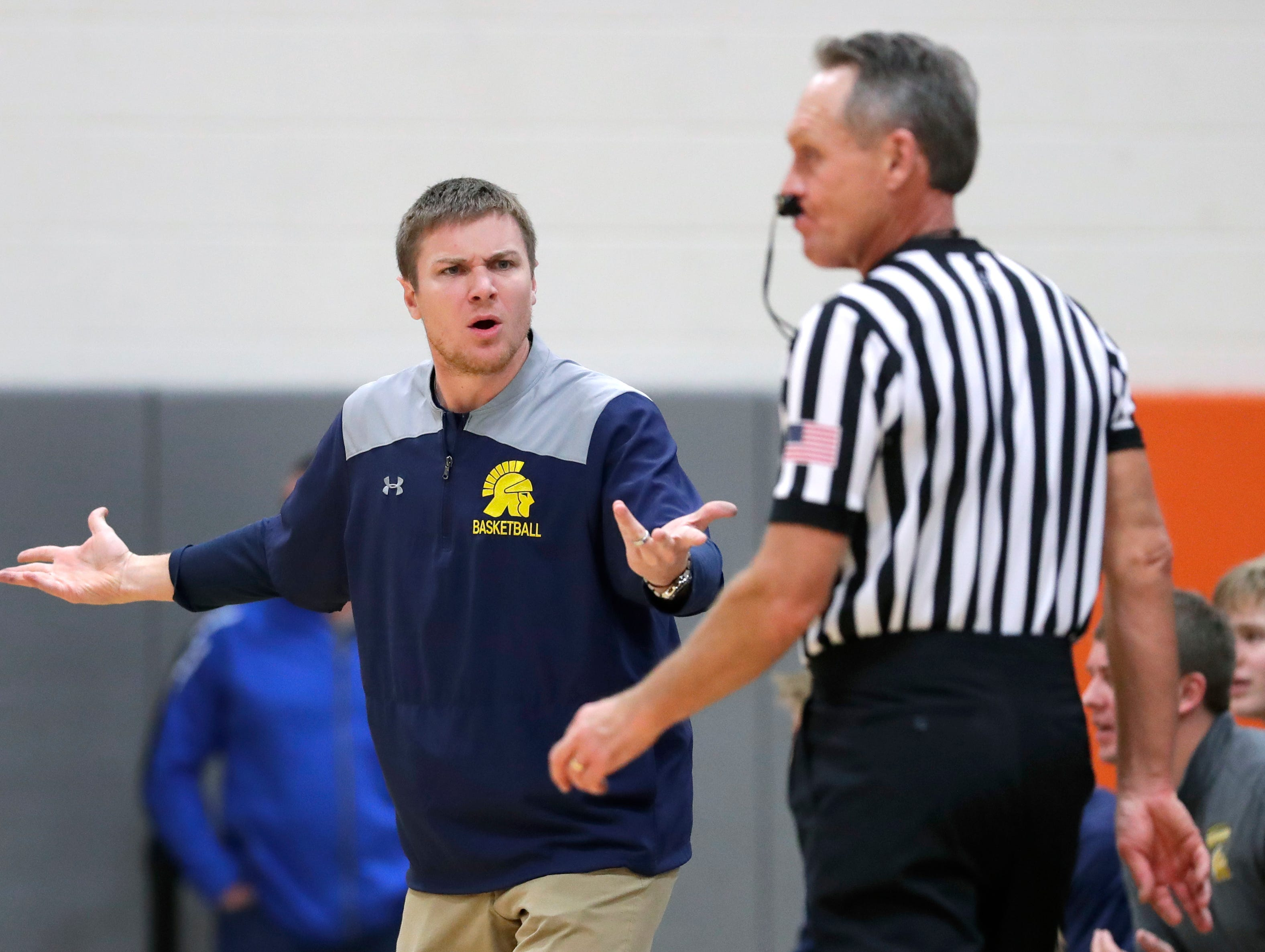 Wausau West High School's coach Nate Lemmens questions a referee's call against his team as they play Appleton West during their boys basketball game Friday, December 28, 2018, in Appleton, Wis. 