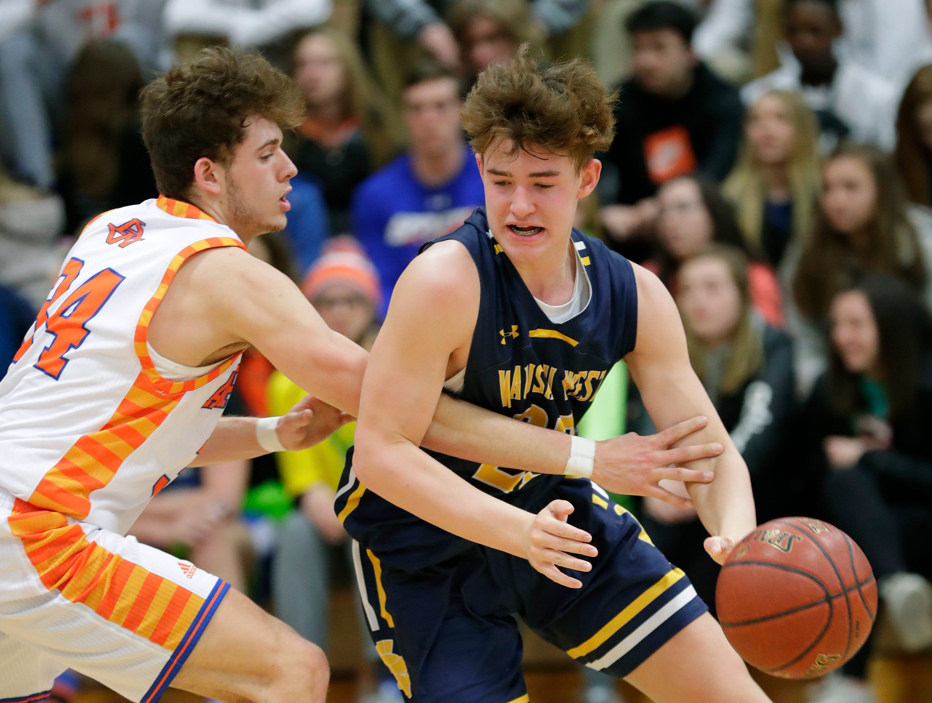 Appleton West  High School's Spencer Mellberg (34) defends against Wausau West High School's Logan White (23) during their boys basketball game Friday, December 28, 2018, in Appleton, Wis. Dan Powers/USA TODAY NETWORK-Wisconsin