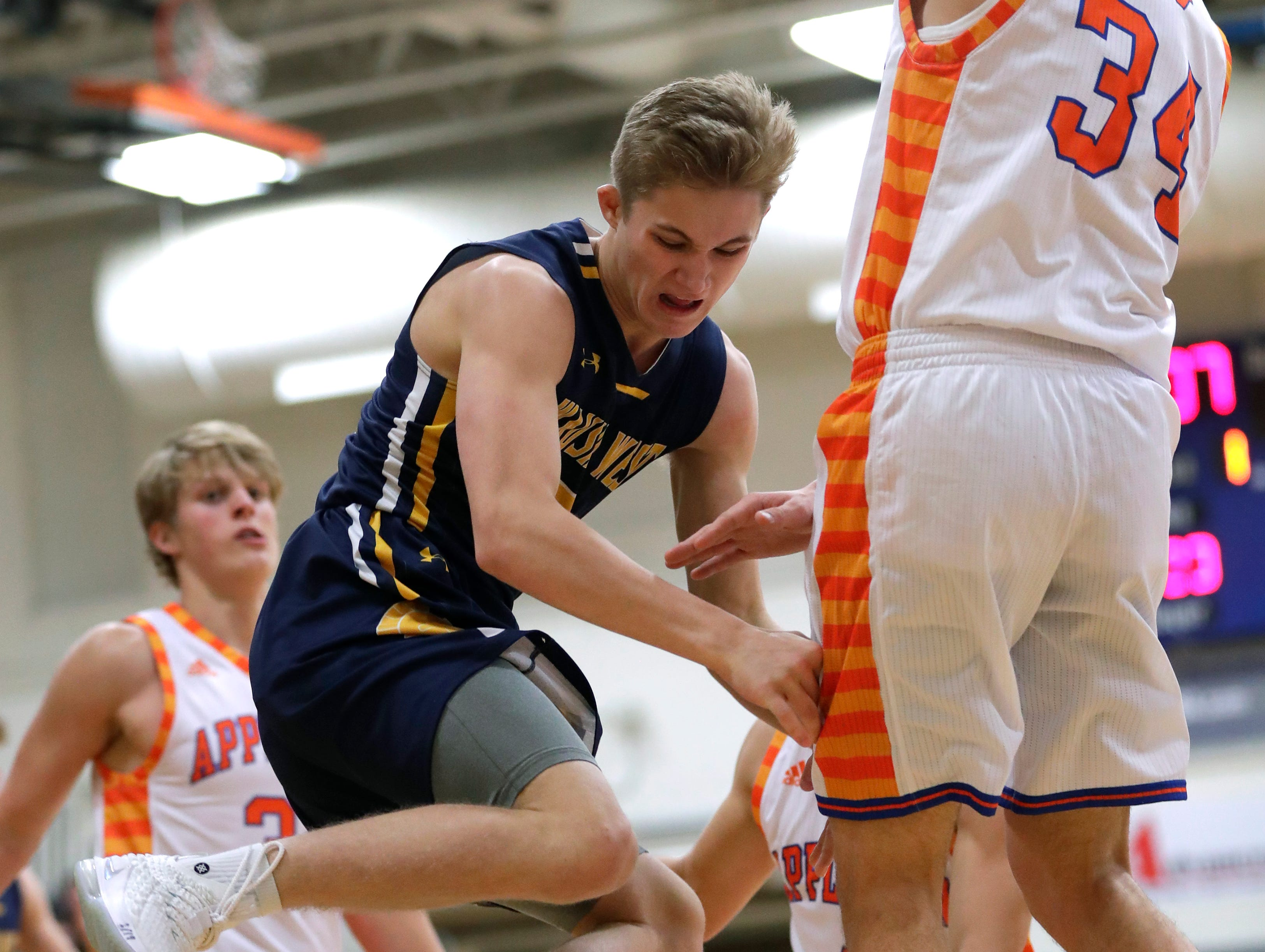Wausau West High School's Mitchell Zahurones (2) is fouled as he drives to the basket against Appleton West  High School's Spencer Mellberg (34) during their boys basketball game Friday, December 28, 2018, in Appleton, Wis. 
