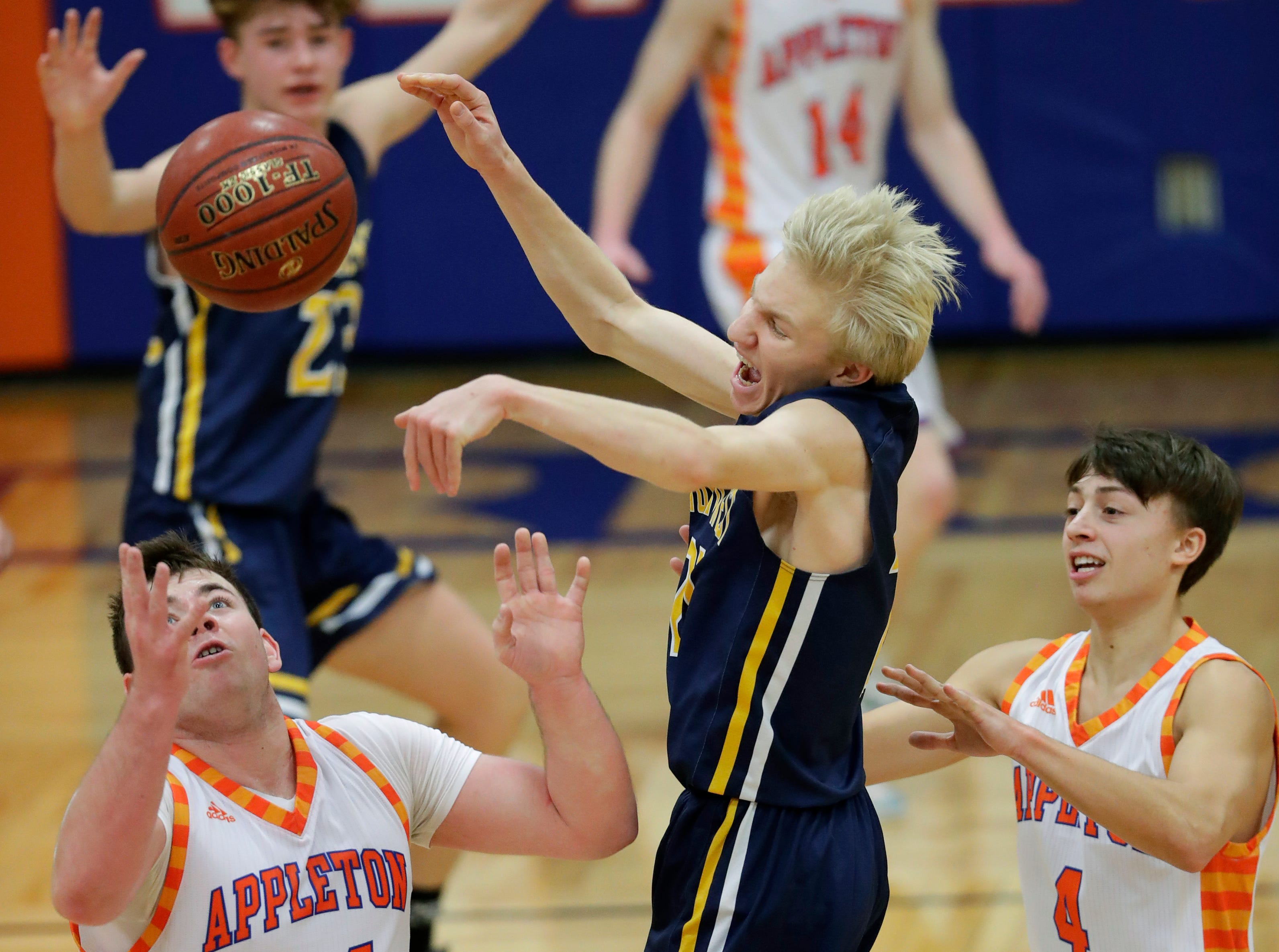 Appleton West  High School's Tyler Tetzke (44) and Eli Vogel (4) pressure Wausau West High School's Ryan Hartman (21) during their boys basketball game Friday, December 28, 2018, in Appleton, Wis. 