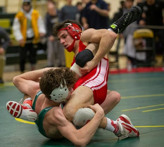 Colts Neck's Luke Rada (left) defeated Paulsboro's Gabe Onorato 3-2 in the 145-pound championship bout of the Mustang Classic. It was a bout filled with scrambles like the one here.