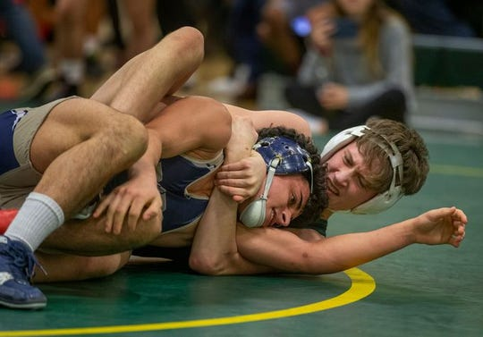 Freehold's Nico Messina (right) defeated Long Branch's Ryan Zimmerman in the 126-pound championship bout of the Mustang Wrestling Classic.